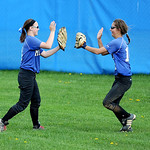 Midview right fielder Erin DiFranco, left, and center fielder Morgan Hamker celebrate an out against Avon. KRISTIN BAUER | CHRONICLE