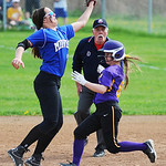 Midview short stop Amanda Beursken jumps to catch a high ball, but misses, as Avon's Alex Kozich slides into second safely. KRISTIN BAUER   CHRONICLE
