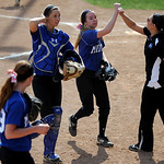Midview pitcher Lauren Landers celebrates with her teammates and coaches after a successful inning pitched. KRISTIN BAUER | CHRONICLE