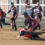 Elyria's Alex Dick is tagged out at second while teammate Madison Fullmer makes a break for home at Brookside West Park in Ashland. RAY RIEDEL/CHRONICLE