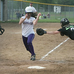 Vermilion runner #17 Sydney Virgin dodges the tag of Buckeye catcher #7 Chessa Grzincic.  photo by Chuck Humel