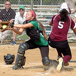 Wellington's #5 Erin Reisinger leaps for home plate as Columbia catcher #10 Sarah Viccarone catches the ball. Erin was safe at the plate.
