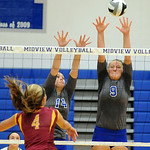Midview's Becca Mullins, right, and Hannah Bell defend against Avon Lake's Devan Rybarczyk. STEVE MANHEIM/CHRONICLE