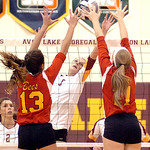 Avon Lake's #6 Katie Mihalik tries to push the ball past Brecksville's #13 Emery Sirna and #11 Nikki D'Anna.