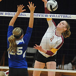 Avon Lake 13 Isabelle Wagner slams past Brunswick Megan Anderson in Div. I district final Oct. 25.  Steve Manheim