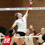 Avon Lake's #12 Christine Bohan leaps to block and pop the ball back to Elyria.