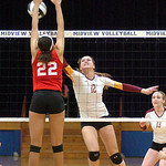 Avon Lake's #12 Christine Bohan pushes the ball past Elyria's #22 Alexis Middlebrooke.