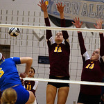 Avon Lake 12 Christine Bohan and 13 Isabelle Wagner defend against St Ursula Cassidy Croci in Div I regional Nov. 2.  Steve Manheim