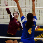 Avon Lake Danielle Donelan hits over St Ursula Erin Williams in Div I regional Nov. 2.  Steve manheim
