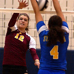 Avon Lake Christine Bogan hits over St Ursula Erin Williams in Div I Regional Nov. 2.  Steve Manheim