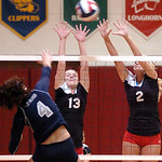 Brooksie&#039;s #13 Kady Whitsel and #2 Shelby Kerstetter leap up to block the spike of Lorain&#039;s #4 Alexis Castro.