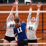 EC's #24 Brooke Nedrich and #27 Rachel Duffield leap to block Midviw's #11 Cassie Haight'ss spike.