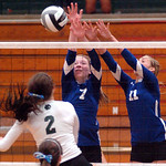 Midview's #7 Meghan Higley and #11 Cassie Haight leap to block EC's #2 Catherine O'Shaughnessy's spike.
