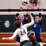 Midview's #14 Molly Albright and #2 Ali Stanziano try to block EC's #24 Brooke Nedrich's spike.