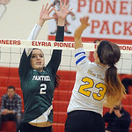 Elyria Catholic's Caitlin Rock hits past Independence's Hallie Zumack in the district final Thursday. STEVE MANHEIM/CHRONICLE