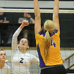 EC's #2 Catherine O'Shaughnessy hits over Avon's Olivia Schneider Sep. 25.  photo by Steve Manheim