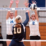 Midview's #14 Molly Albright and #2 Ali Stanziano block North Ridgeville's #10 Julie Hansen's spike.