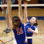 Open Door's #9 Lauren Turner spikes the ball past First Baptist's #11 Morgan Niemier.