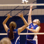 First Baptist #6 Katelyn Kime tries to spike the ball past Open Door's #6 Christa Mindling.