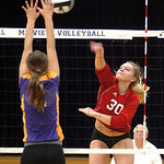 Elyria's #30 Emily Mandoke spikes the ball past Avon's #2 Olivia Boccabella.