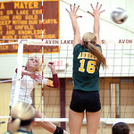 Avon Lake's Katie Mihalik spikes the ball past Amherst's Ashley Makruski. LINDA MURPHY/CHRONICLE