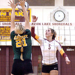 Avon Lake's Devan Rybarezyk tries to spike the ball past Amherst's Mallory Sliman.  LINDA MURPHY/CHRONICLE