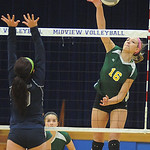 Amherst Ashley Makruski hits over Lorain Serena Rodriguez Oct. 17.  Steve Manheim