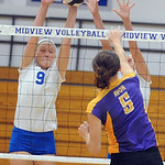 Midview 9 Becca Mullins defends against Avon Brianna Conroy Oct. 14.  Steve Manheim