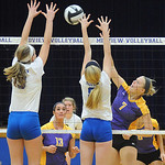 Avon 7 Megan Romanchok hits past Midview Becca Mullins, left, and Lauren Landers in sectional Oct. 14.  Steve manheim