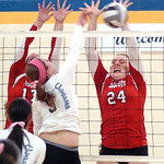 Lutheran West's Gabby Schultz blocks a spike from Clearview's Jackie Kokinda. LINDA MURPHY/CHRONICLE