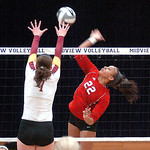 Elyria's Alexis Middlebrooks tries to spike the ball past Avon Lake's Katie Coughlin. LINDA MURPHY/CHRONICLE