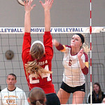 Avon Lake's Katie Mihalik spikes a ball past Elyria's Abigail Elek. LINDA MURPHY/CHRONICLE