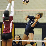 Lorain's Marlena Guice hits past Maple Heights' Ammaarah Williams.  Steve Manheim