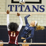 Lorain's Raegan Osko hits past Maple Heights' Ebony Harris on Sept. 26.  Steve Manheim