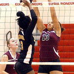 Wellington's #13 Raven Howard blocks Beachwood's #3 Anetsha Hardins pop.
