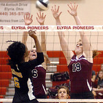 Wellington's #6 Katherine Gilbert and #19 Jill Jackson try to block Beachwood's #6 Valesha Watkins' spike.