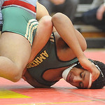 Amherst's David Moody loses in the 152-pound weight class at Brecksville. STEVE MANHEIM/CHRONICLE