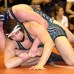 Lorain's Adam Kutcha, top, lost to Westlake's Yousef Mustafa in the 195-pound championship match. LINDA MURPHY/CHRONICLE