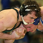 Elyria Catholic's Jerot Schill wrestles for a takedown while earning a 5-2 decision over Tanner Topp from Northwestern. RICK TWINING/CHRONICLE