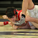 Lutheran West's Jake DeLorge pins Loudonville's Drew Lowery in 1:05 of the first period. RICK TWINING/CHRONICLE