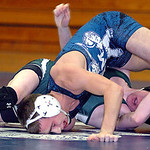 Midview&#039;s (top) Drew Schatz wrestles EC&#039;s Sean Kilbane.