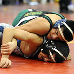 Amherst'S Alex Reyes, top, defeats Lorain'S Caleb Kopp. STEVE MANHEIM/CHRONICLE