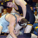 152-pound championship match: Avon Lake's Jimmy Emerson works on Holy Names Jimmy Klosz. Klosz won the match.