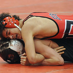 Elyria's Mikah Price defeats Oregon Clay in the 138 weight class in dual finals. STEVE MANHEIM/CHRONICLE