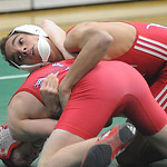 Lutheran West's Adrian Diaz, top, defeats Oberlin's Robby Cobb in the 120 weight class. STEVE MANHEIM/CHRONICLE