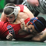 Lutheran West's Adler Vasiloff defeats Oberlin's Kobe Fields in the 145 weight class. STEVE MANHEIM/CHRONICLE
