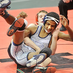 Devione Edwards, front, of Lorain is brought down by Cincinnati LaSalle's Eric Beck in a 106-pound match. DAVID RICHARD