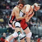 Elyria's Amando Torres tries to hold onto Hilliard Davidson's Aaron Assad during the Division I 113 pound championship match Saturday in Columbus.