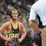 Black River's Sebastian Vidika listens to Head Coach Kory Kline during a break in the Division III 106 pound consolation match at the state tournament in Columbus on Saturday. Vidika lost t …