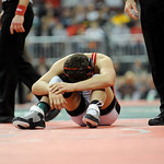 Elyria's Amando Torres sits in disbelief after losing to Hilliard Davidson's Aaron Assad in the Division I 113 pound championship match Saturday in Columbus.